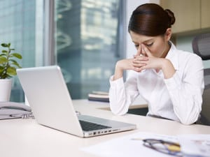 Tired-woman-at-desk_opt