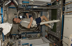 An astronaut uses a zero-gravity treadmill on the International Space Station.
