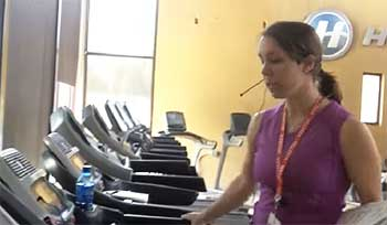 Team member Rachael taking a look at the Horizon Adventure 3 Treadmill at company headquarters.